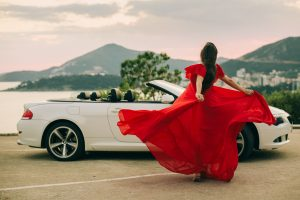 woman in dress travel by car