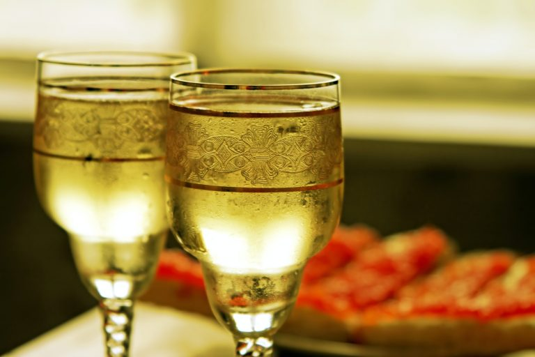 Champagne glasses and red caviar