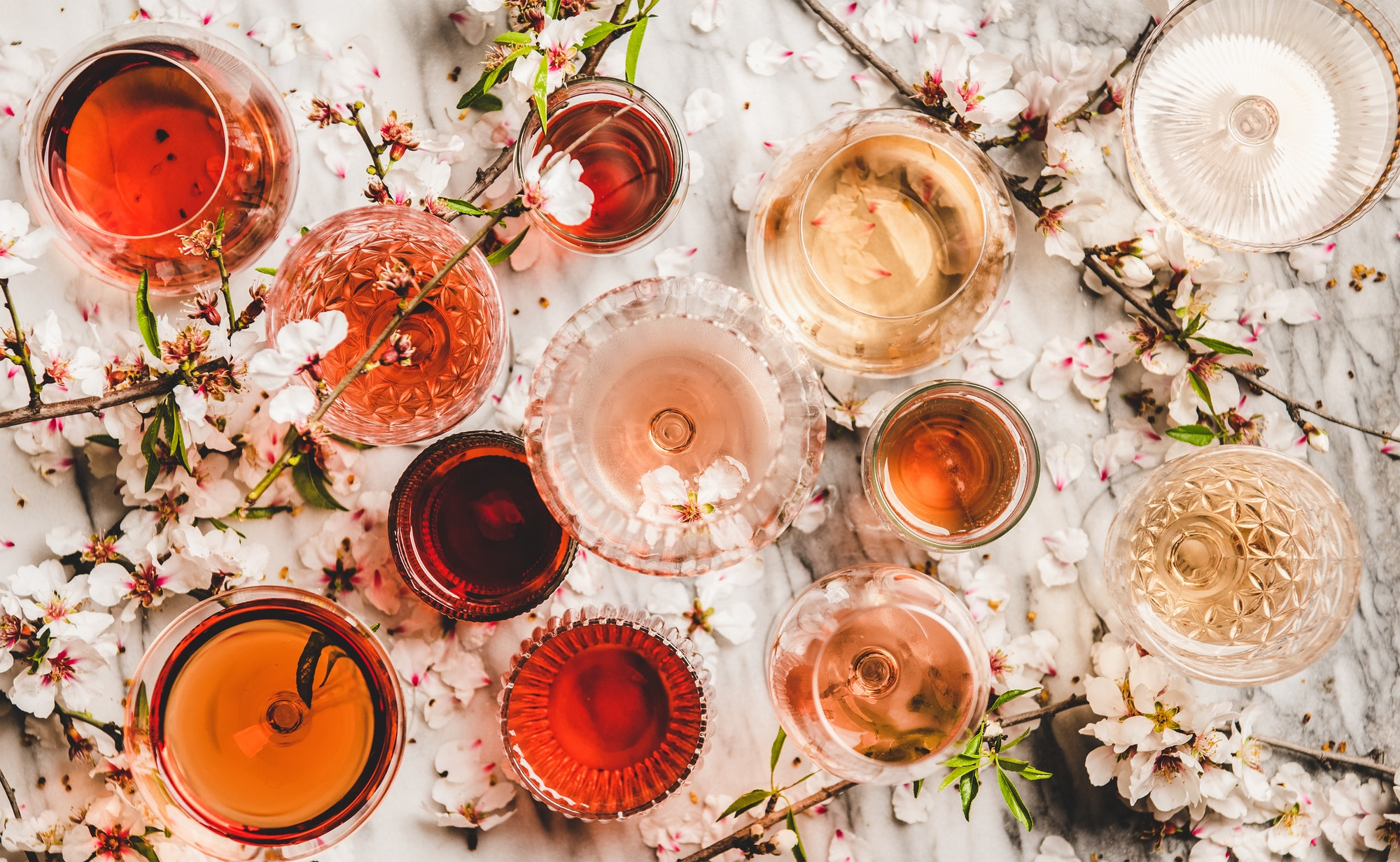 Flat-lay of rose wine in different colors in glasses