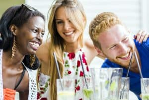 Happy young people laughing a being happy at a table