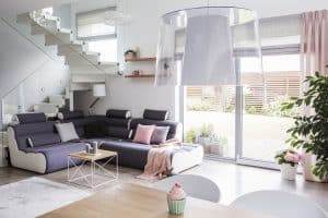 Transparent light shade above a wooden dining table in a white l