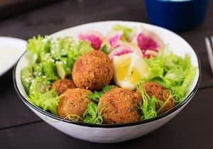 Falafel and fresh vegetables. Buddha bowl.