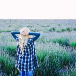 Young blonde woman alone in a lavender field