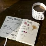 Closeup of wedding checklist notebook on wooden tabel
